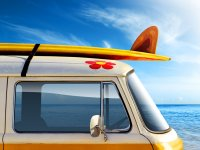 Colourful VW van with surf board
