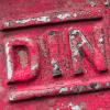 DIN Schriftzug als Metallprägung