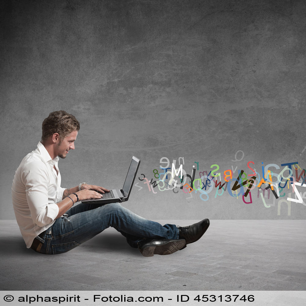 Young man sitting on the ground and letters flying from his laptop